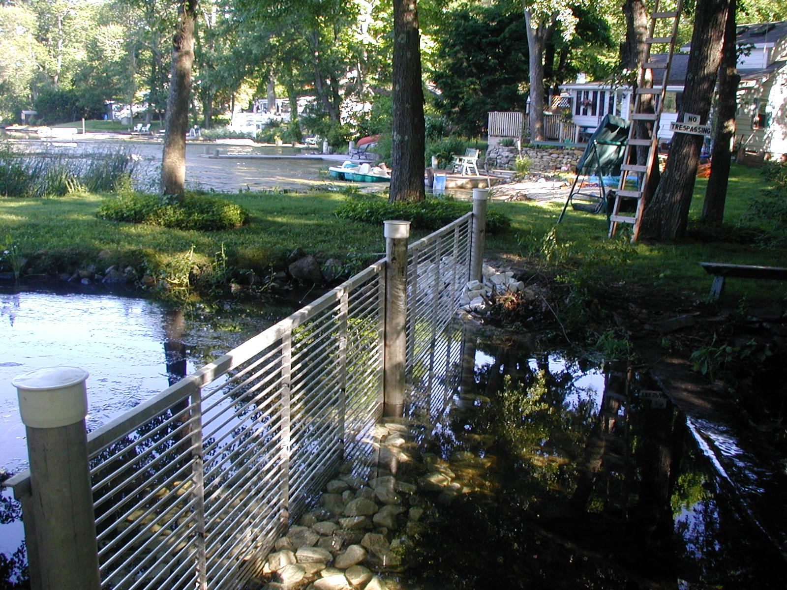 Completed carp fence along the water